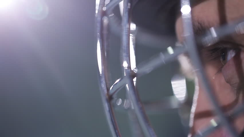 Close-up face hockey goalie. Hockey goalkeeper is on the gate waiting for the opponent | Shutterstock HD Video #23207290
