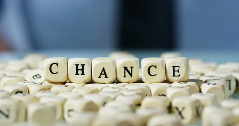 """Young businessman hand replace the word """"Chance"""" with  the word """"Change"""" of the wooden letter blocks . Concept of financial market and future of stock market business."""