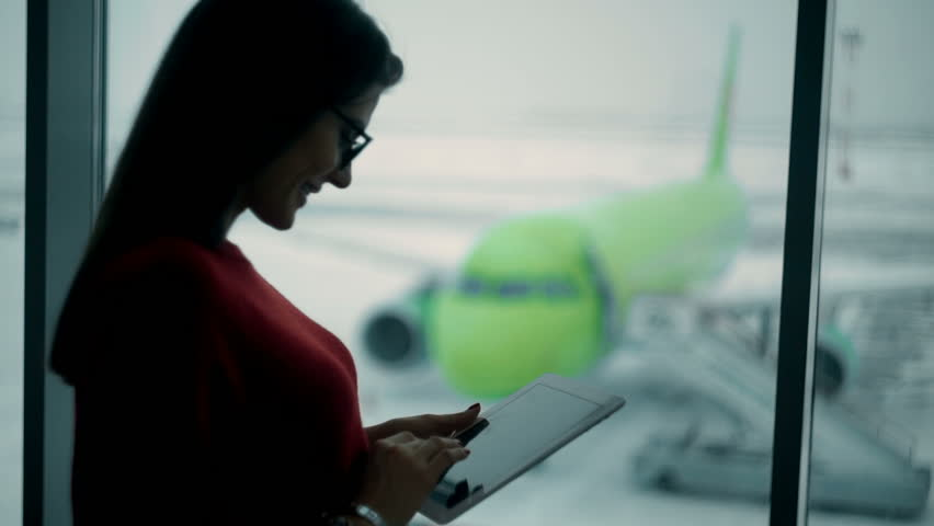 Young woman using tablet in at the airport | Shutterstock HD Video #23311720