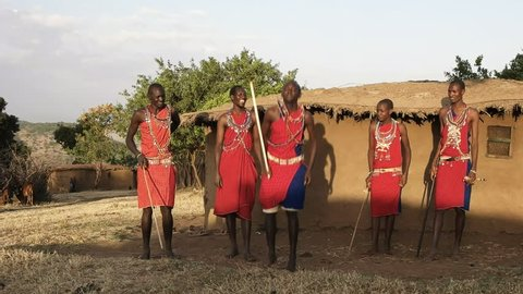 60p wide shot of five maasai warriors dancing at a village near masai mara- originally recorded at 120fps