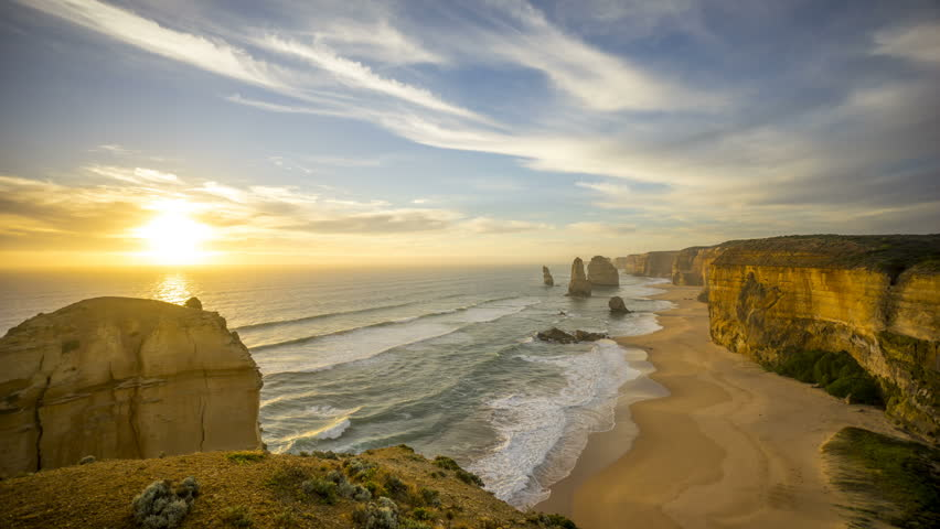 Time lapse of summer sunset at beautiful rock formation along the coastline - The 12 Apostles, Port Campbell, Victoria Australia. Time lapse with brush stroke and long exposure effect. zoom in