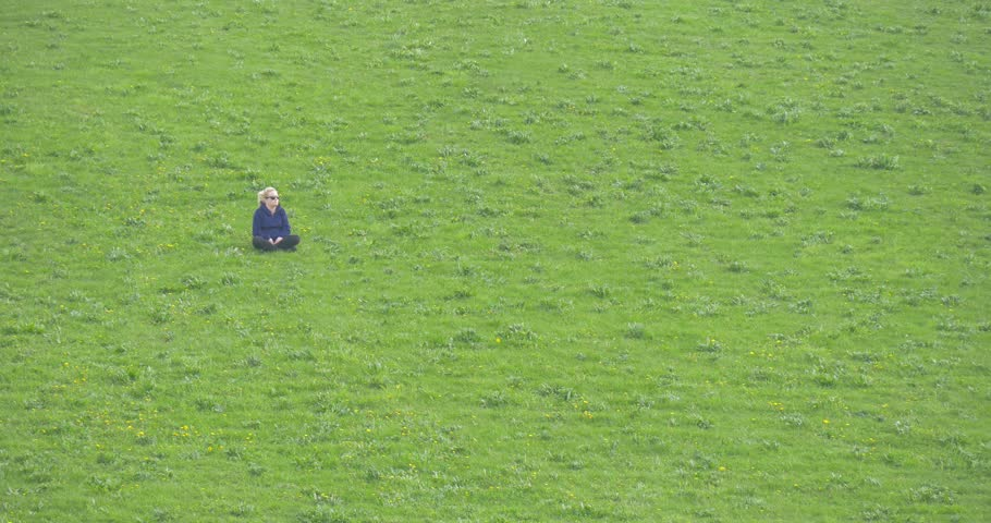 Opole/poland - May 02 2016: a Young Girl Sits on a Grass on a High Hill. She From Apart Observes of a Cavalry. the Cavalry Acts With Representation Before Visitors of Festival of Arms in Opole | Shutterstock HD Video #23436964