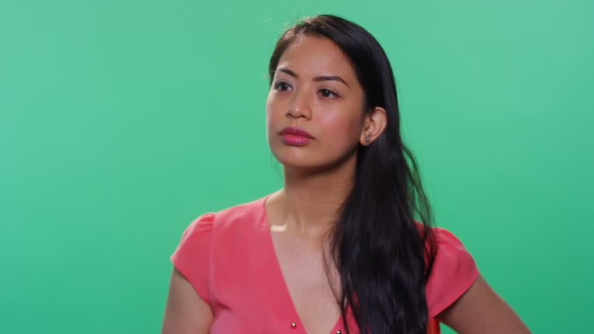 Asian woman on green background smiling | Shutterstock HD Video #23437000