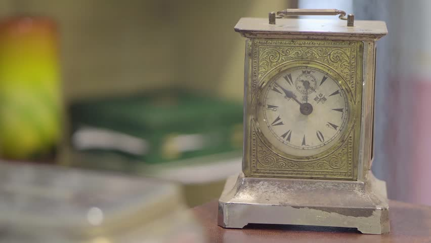 The camera shows a golden clock. | Shutterstock HD Video #23437660