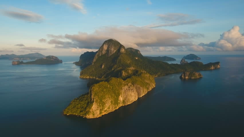 Tropical bay in El Nido. Aerial view: bay and the tropical islands.Tropical landscape. Sky and mountains rocks.Aerial video. Seascape:sky,mountains, ocean. Philippines, El Nido. 4K video. Travel
