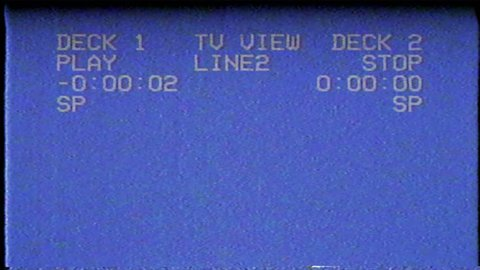 A flickering, analog TV signal with bad interference, static, and color bars.