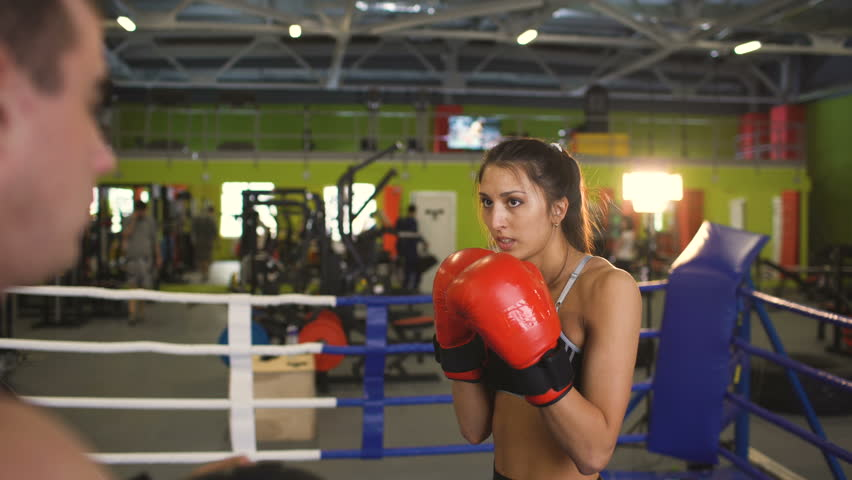 Young Woman Boxer Training Pre Match Warm Up In The Boxing Ring With Her