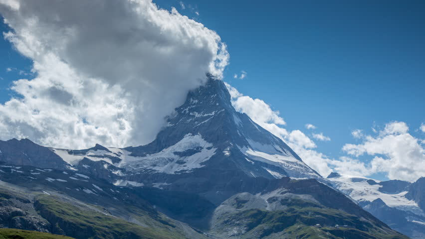 zooming timelapse of the amazing matterhorn and surrounding mountains in the Swiss Alps with fantastic cloud formations
