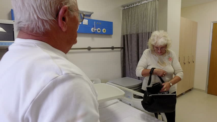 Senior patients at hospital worried holding documents before surgical operation | Shutterstock HD Video #23522890