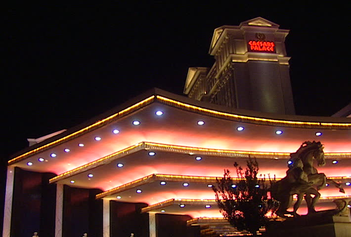 LAS VEGAS - Circa 2002: Caesars Palace loading area at night, limo drives through