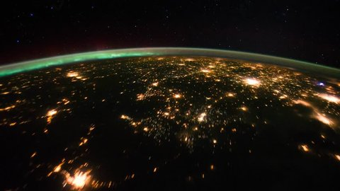 Aurora time lapse across the Aurora Borealis and the Chicago and eastern Canada at night from space in 4K
