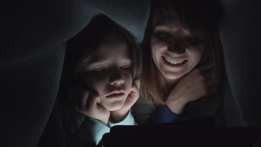 4k Shot of Child and Mom Looking on Tablet under Blanket | Shutterstock HD Video #23570383