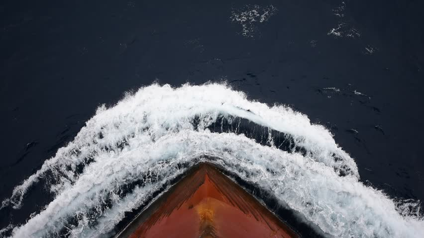 Ship's bow, moving through the waves to her destination. View from forecastle deck. | Shutterstock HD Video #23612770