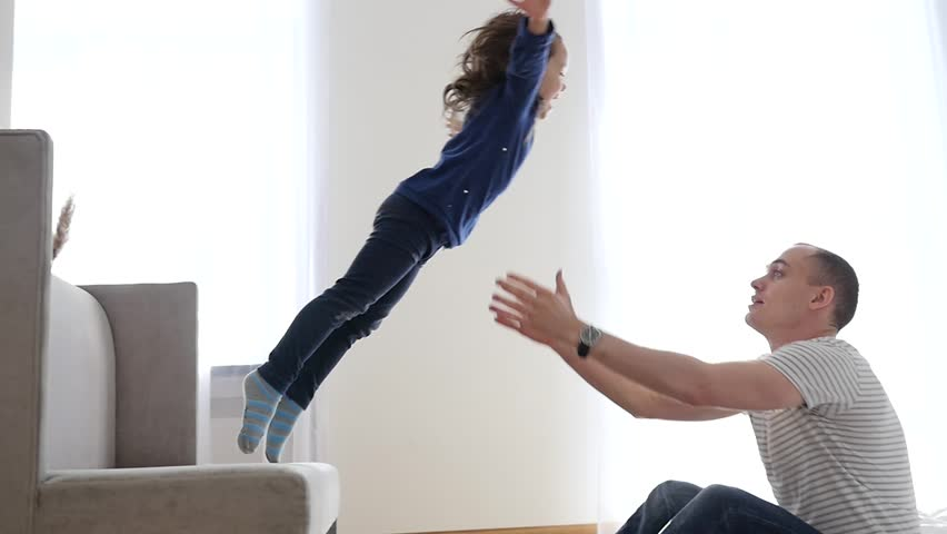 Happy Family Idyll Little Child Daughter Jump On Father Arms And They Fall On A Bed | Shutterstock HD Video #23641600