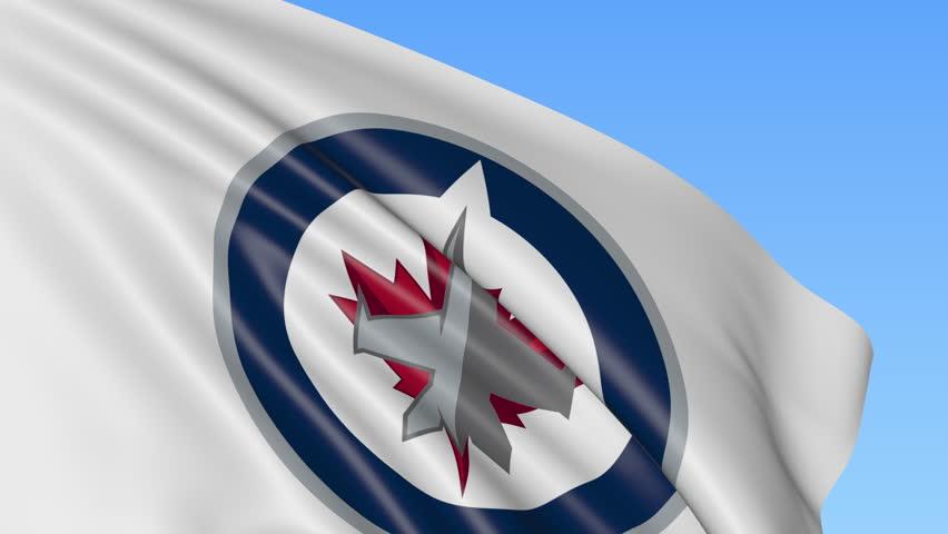 Close-up of waving flag with Winnipeg Jets NHL hockey team logo, seamless loop, blue background. Editorial animation. 4K