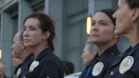 Female Police Officers at Rally. Police officers watch and maintain a safety perimeter at a rally for Trayvon Martin in downtown Los Angeles, California on July 16th, 2013.