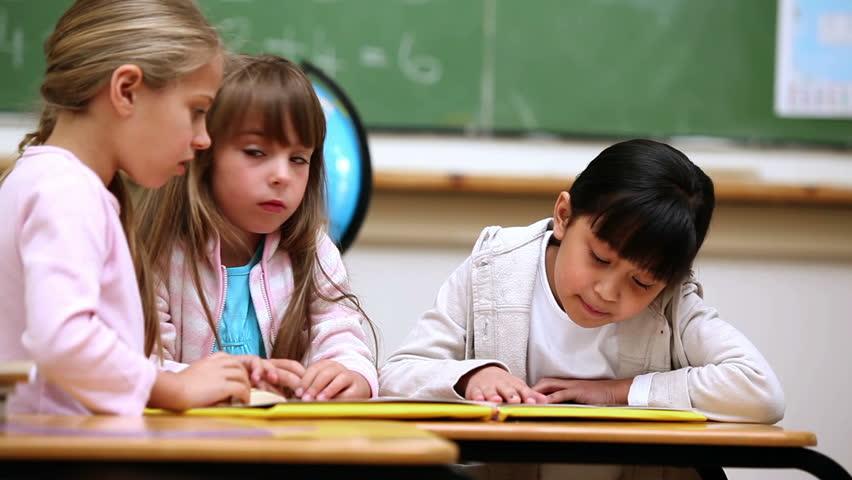 Pupils reading a book in a classroom | Shutterstock HD Video #2372600
