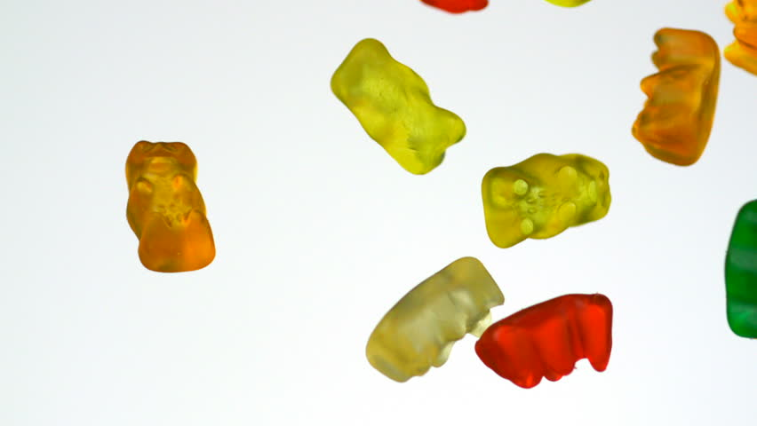 Colorful gummy bear falling in the air shooting with high speed camera, phantom flex.