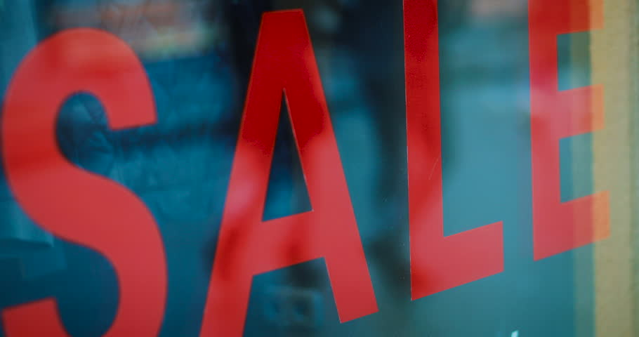 Big sale sign, people pass by in the background, in slow motion | Shutterstock HD Video #23738590