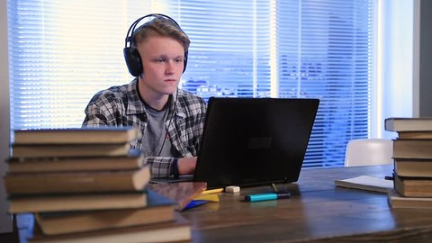 Serious student e-learning online with laptop