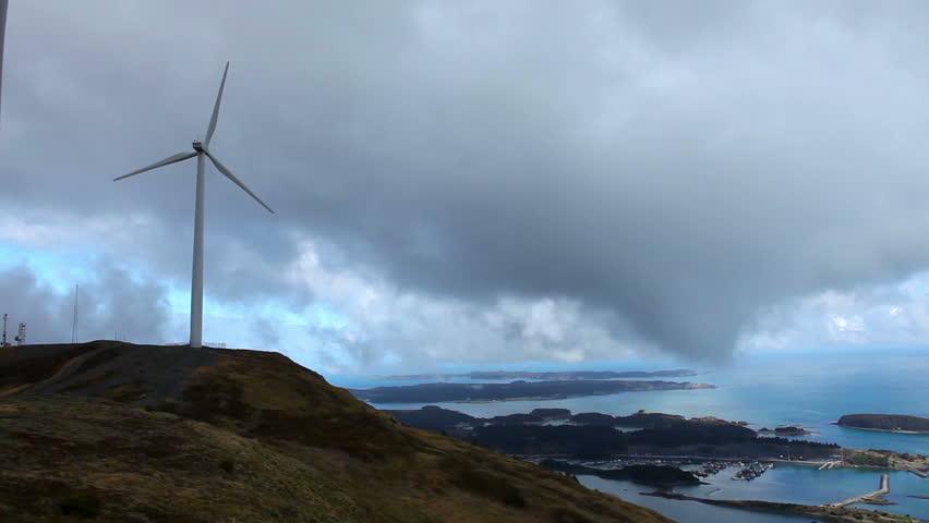 Wind turbines stand on Pillar Mountain on Kodiak Island on a cloudy day, Alaska, Spring
