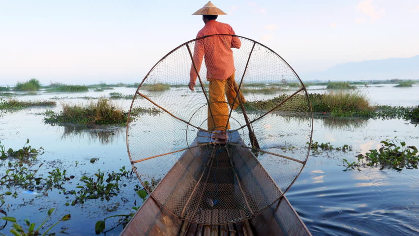 Inle Lake fisherman rowing boat in traditional style at sunrise, Shan State, Myanmar (Burma). #23786740