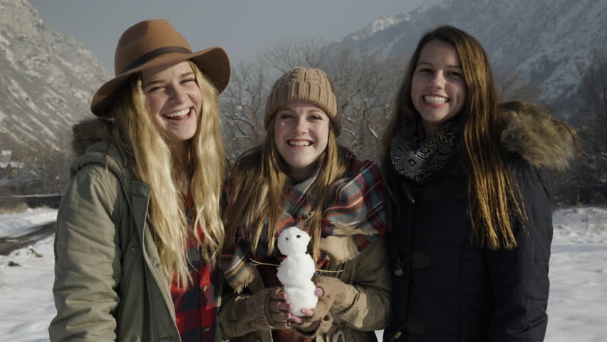Fun Group Of Teen Girls Pose With Tiny Snowman, They Hug And Laugh