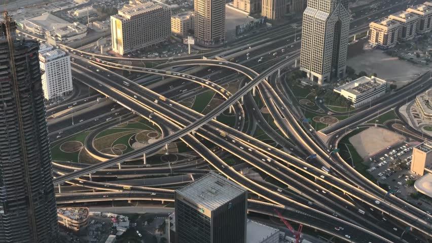 DUBAI, UAE - DECEMBER 2016: Aerial view of traffic intersections. Dubai suffers heavy car traffic. | Shutterstock HD Video #23812750