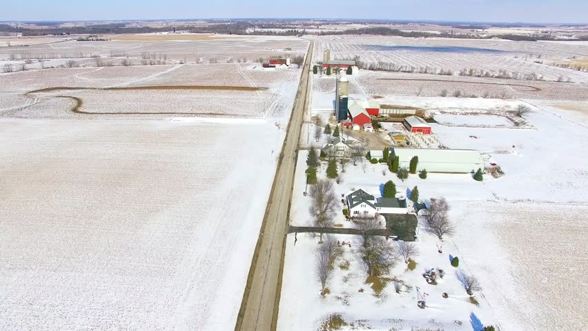 Scenic Winter flight down country road with, Farms, Silos, amazing flock of birds by silos.