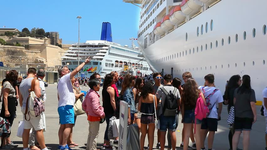 VALLETTA, MALTA - MAY 16, 2016: Tourists boarding the cruise ship after an excursion tour on May 16, 2016 in Valletta, Malta