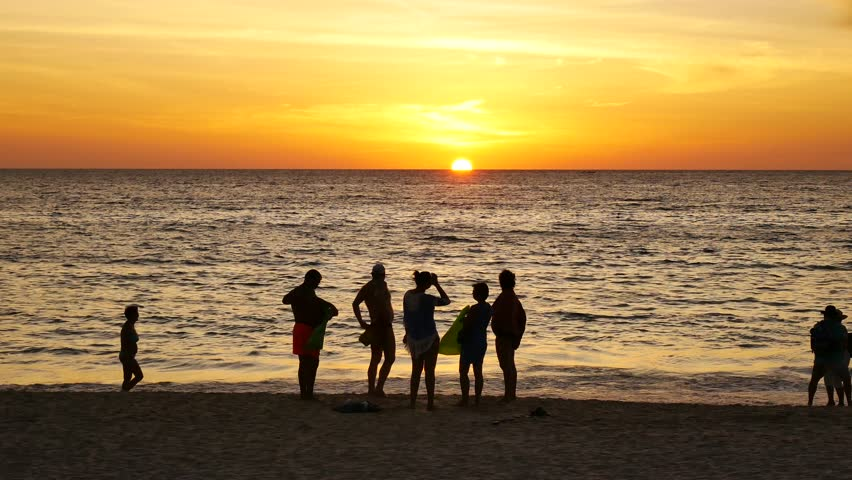 silhouette people with sunset on the beach #23908900