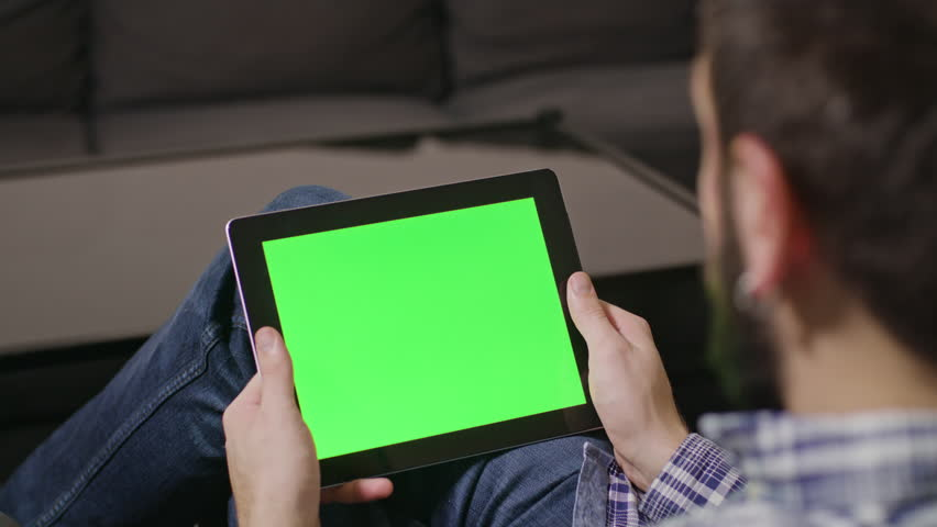 Young man using digital tablet pc with blue screen sitting at home. zoom | Shutterstock HD Video #23925925