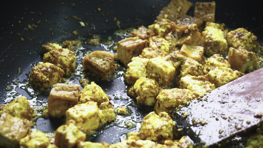 fried paneer in the pan. Vegetarian cuisine and its dishes.
