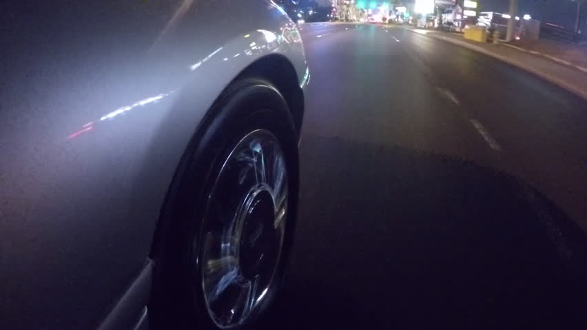 Limo driving the strip in Las Vegas passenger wheel close-up time-lapse shot