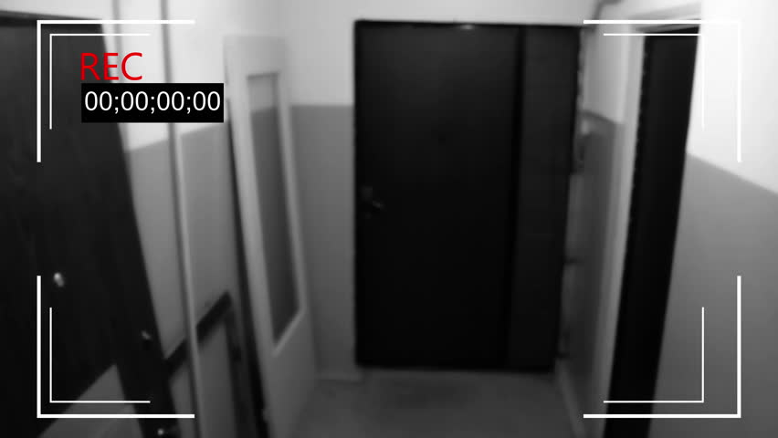 The young man in the mask breaks the door and breaks the surveillance camera | Shutterstock HD Video #23943580