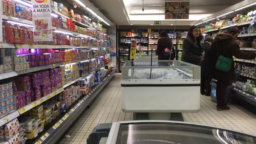 Refrigerated Products In Supermarket With People Shopping  LISBON  PORTUGAL    25 JANUARY 2017. MOSCOW  RUSSIA   OCTOBER 14  2016  Many Different Goods Are On The