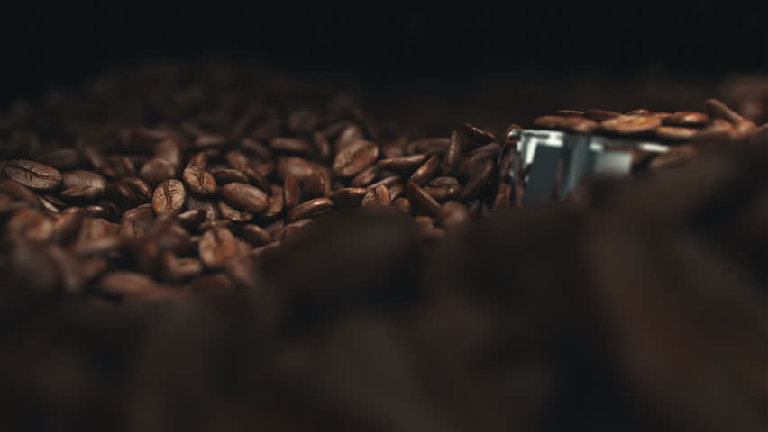 Coffee beans in the grinder. Two high quality videos of coffee beans in the grinder. Super slow motion video.