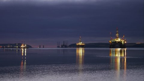 Timelapse of Silhouette of Semi Submersible Oil Rig and Big Boat at Cromarty Firth in Invergordon, Scotland (4K Timelapse)