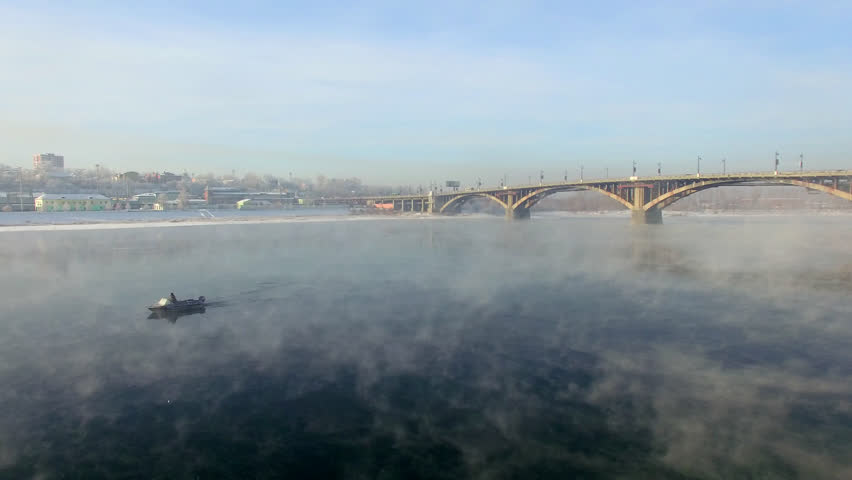 Aerial view from the air. Winter. Irkutsk city. Russia. Siberia. View of the bridge across the Angara River