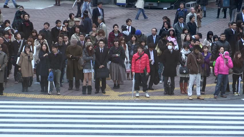 a8421fca2 Tokyo, JAPAN - CIRCA NOVEMBER 2016- People waiting in cross intersection.  Japanese men and women standing still waiting to cross the street.
