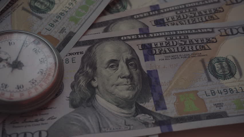 Time and Dollars. Close-Up     Shutterstock HD Video #24125530