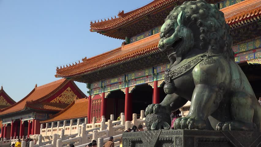 Epic green Chinese Imperial guardian lions. Forbidden city Beijing capital of China. Emperor palace. Old Asian culture. Beautiful summer day, Blue sky. Cinematic 4K.   Shutterstock HD Video #24132208
