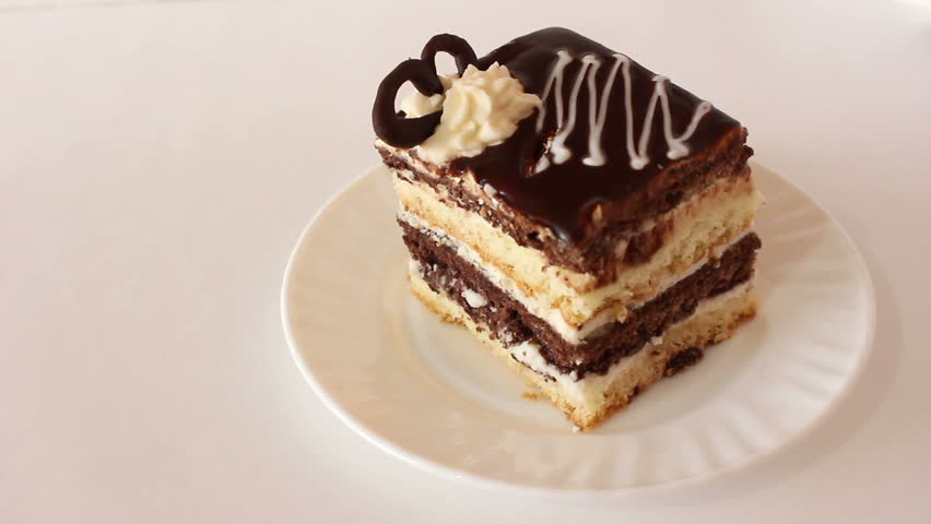 Piece of chocolate biscuit cake eaten with fork | Shutterstock HD Video #24138640