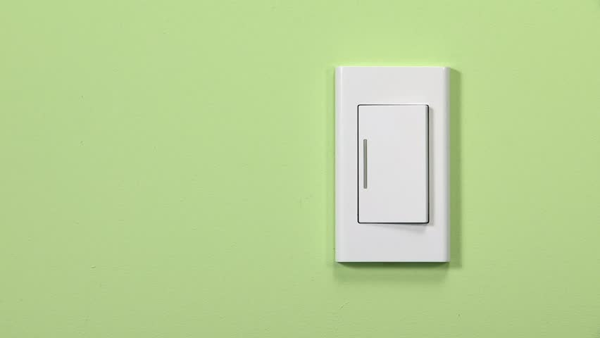 a woman's hand trying off a light switch.