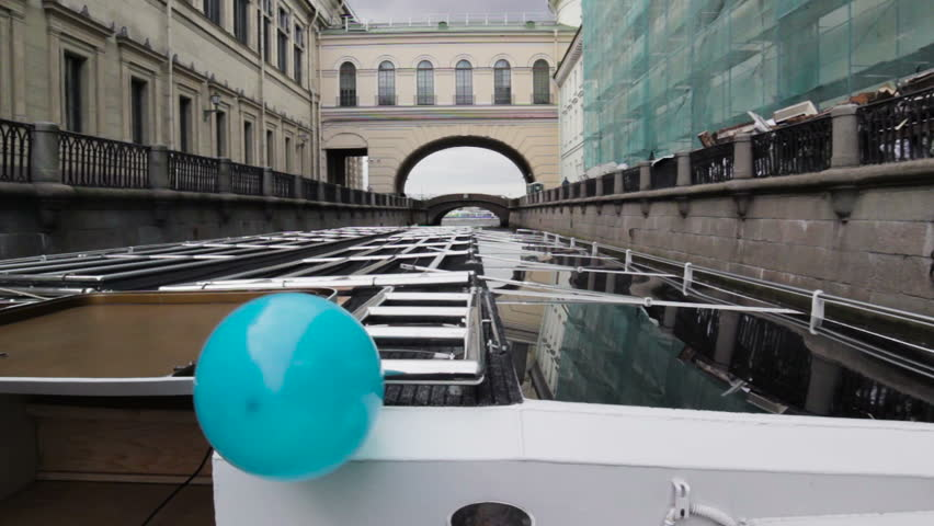 The boat goes through the channel in center St. Petersburg, shooting from floating ship. The river bus.