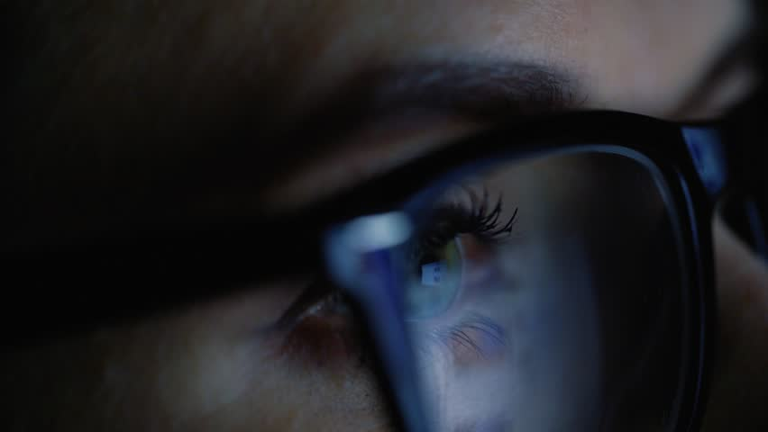 Woman in glasses looking on the monitor and surfing Internet | Shutterstock HD Video #24165730