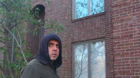 Man angry at a house, stalker, ex-boyfriend concept