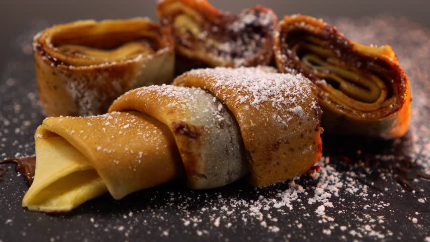Amazing French Crepe fresh baked pancake with melted chocolate   Shutterstock HD Video #24200620