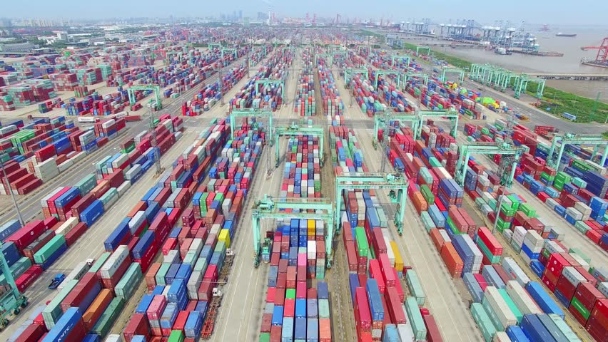 Container ship in import export and business logistic.By crane , Trade Port , Shipping.Tugboat assisting cargo to harbor.Aerial view. | Shutterstock HD Video #24217630