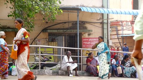 CHENNAI, INDIA - SEPTEMBER 18th, 2015: patients seeking medical treatment waiting outside government hospital building in chennai, india